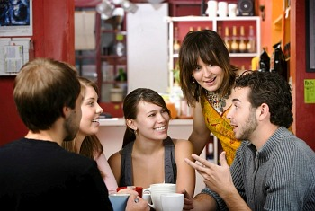 Photo of friends drinking coffee and discussing