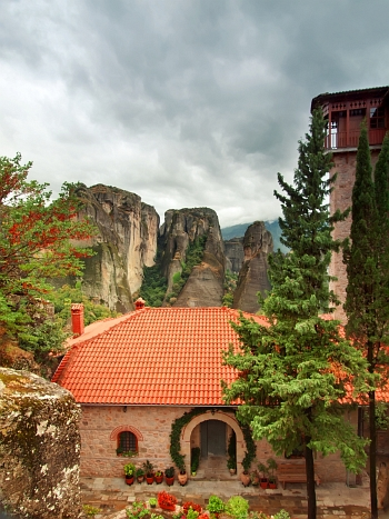 Beautiful colorful yard with flowers at Holy Monastery of Roussano, Meteora