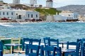 Dinner by the sea backdropped by the beautiful sea and the famous windmills, Mykonos island