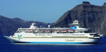 Celestyal Olympia ship cruising on the vivid blue Mediterranean waters towards Santorini island