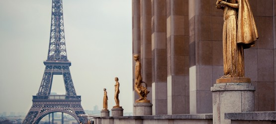 Golden statues on Trocadero with view of Eiffel Tower in Paris, France